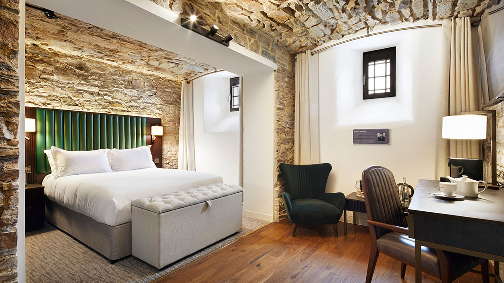 The room at Bodmin Jail hotel combines three cells together