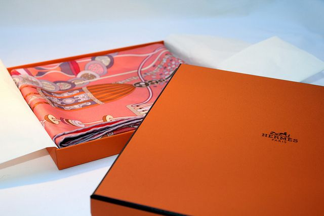 An Hermès scarf in the default orange package