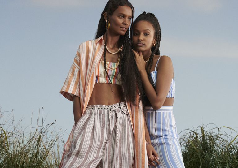Liya and her daughter Raee in clothes from the collection