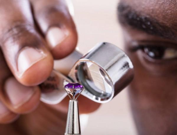 jeweler-examining-diamond-loupe